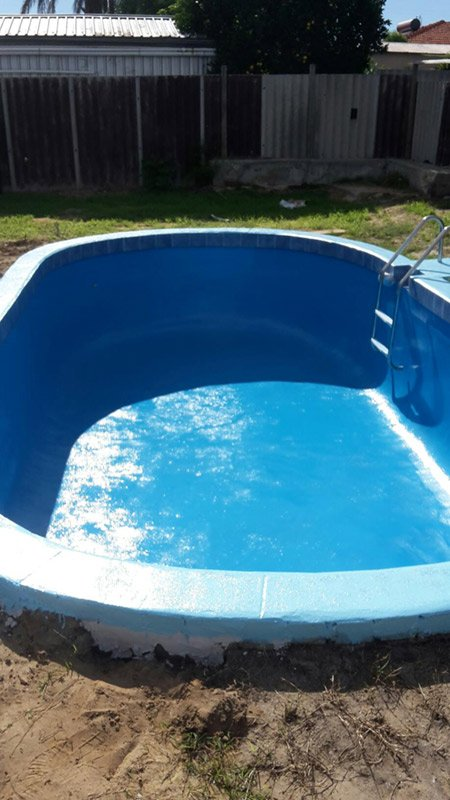 small circular pool with new blue paint