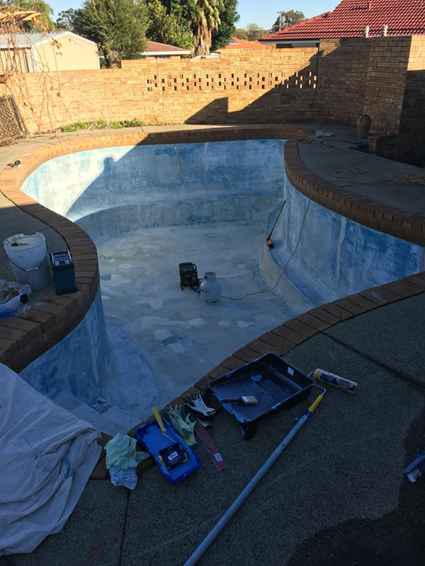 swimming pool in process of being painted