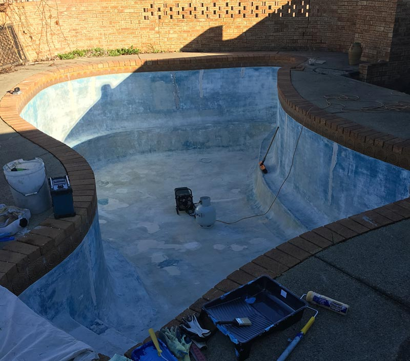 pool being painted and paint tools