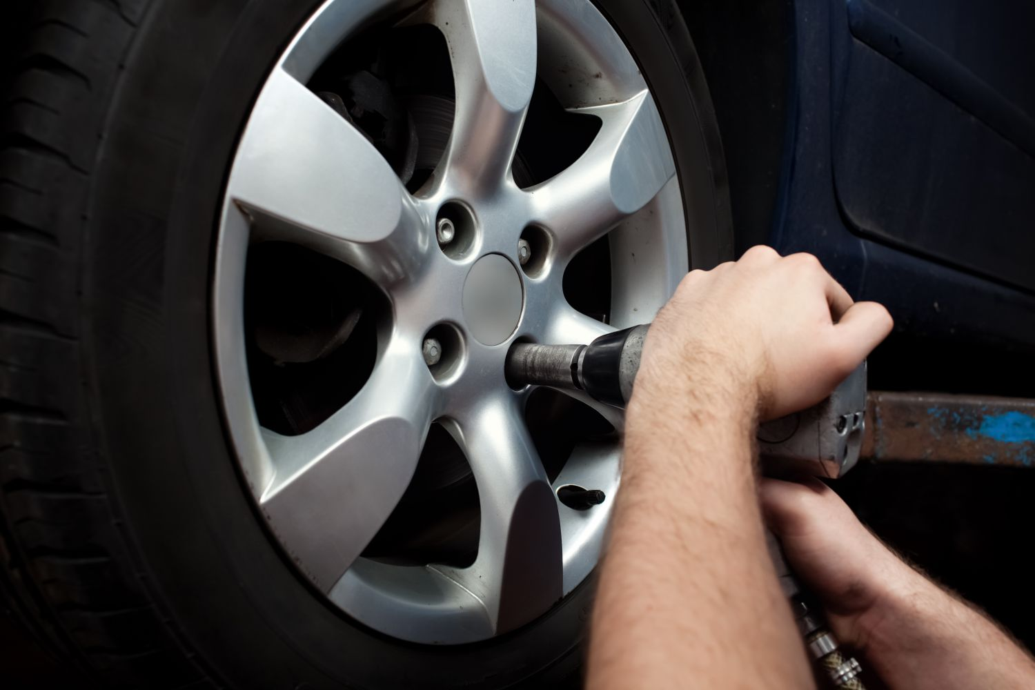 One of our mechanics at work at used tire dealer in Houston