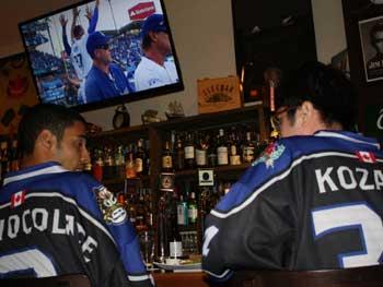 Hockey players watching baseball