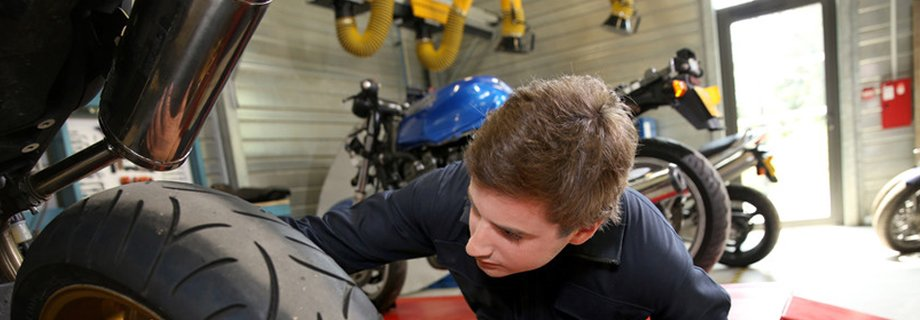 Technician working on a motorcycle