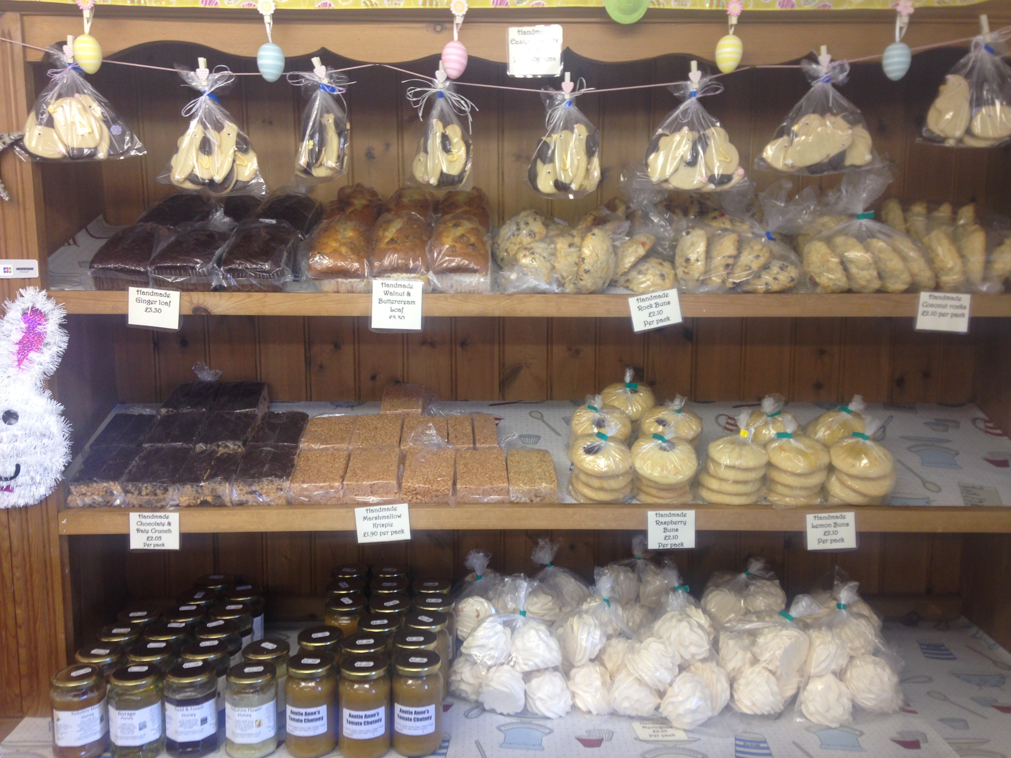 Famous Yorkshire curd tarts and various other baked goods on shelfs in our bakery