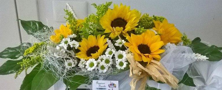 Composizione floreale con girasoli e settembrini