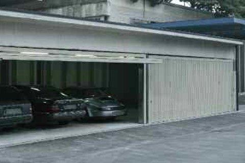 porta basculante speciale - Modello grande dimensione-vista laterale
