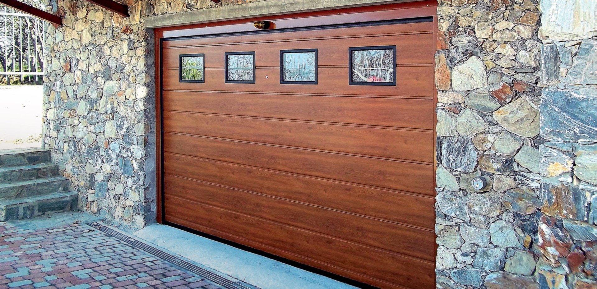 Produzione porte sezionali porte basculanti serrande for Sandrini serrande