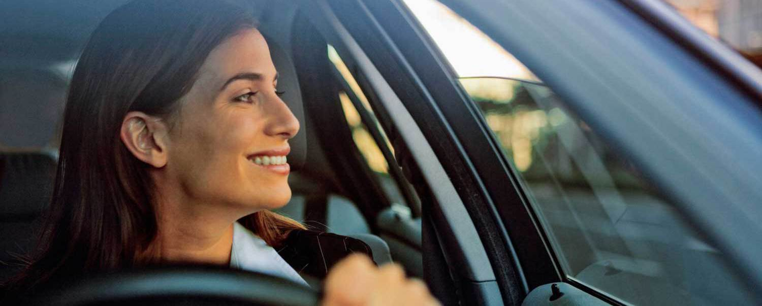 Woman is satisfied with auto glass replacement in Canton, GA