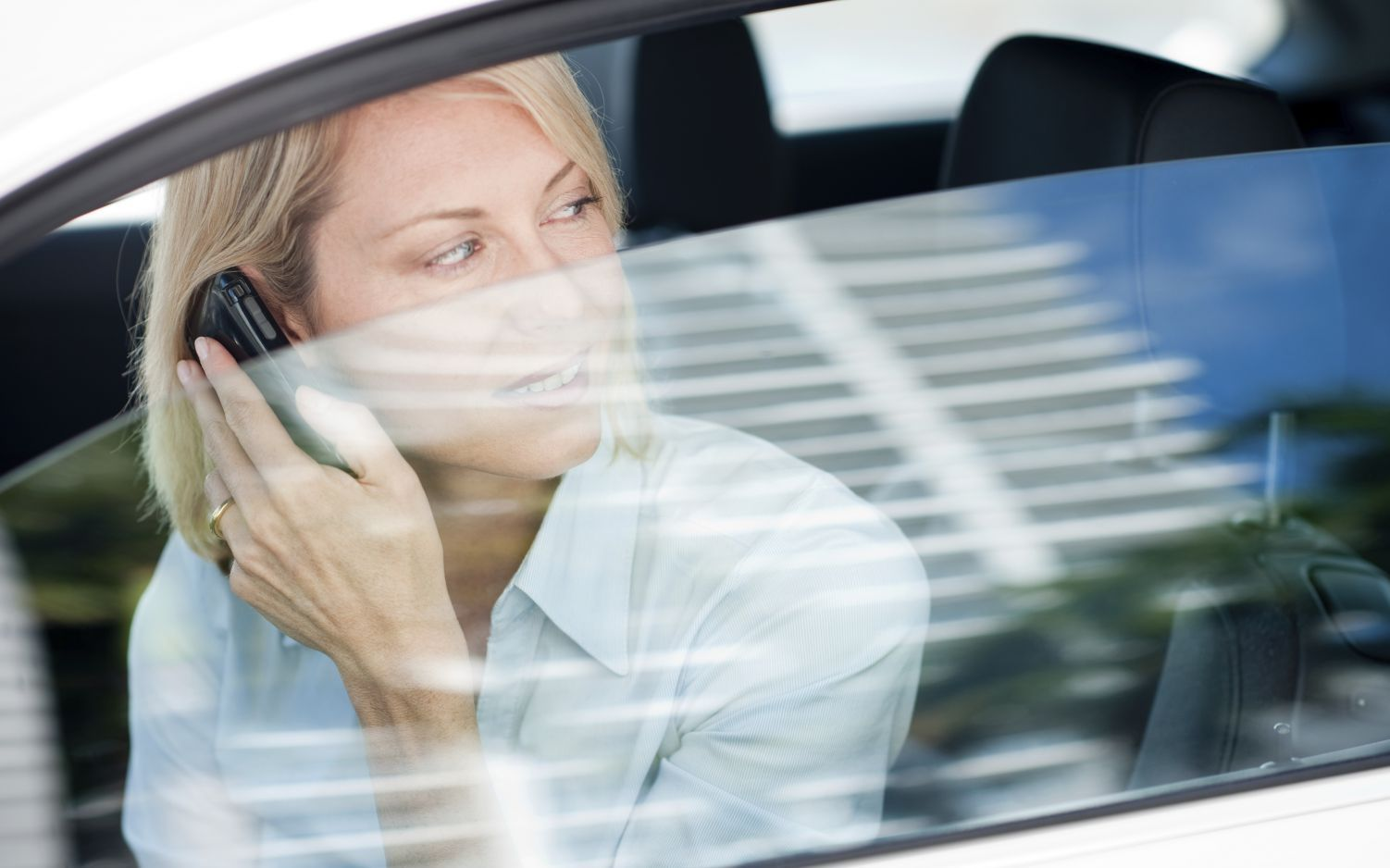 Woman calling about auto glass replacement in Canton, GA