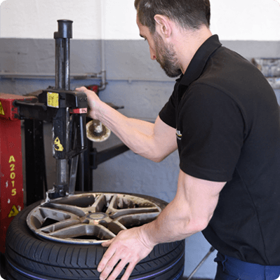 Mechanic at Budjet Tyres checking tyre pressure