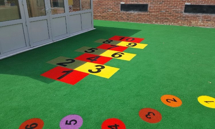 School Playground surfacing design & installation at St Margret's Prep School in Halstead, Essesx | Playcubed Playgrounds