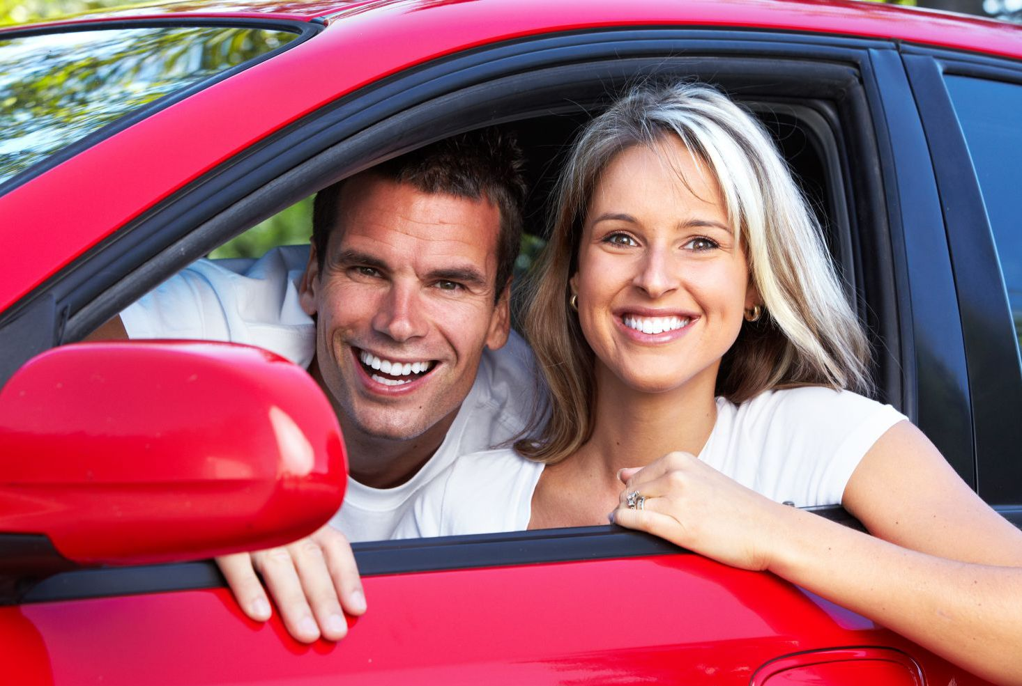 Happy couple in car after suspension repair and service in Wailuku, HI
