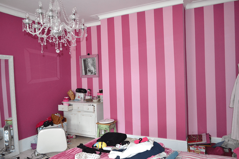 Room with pink painted walls