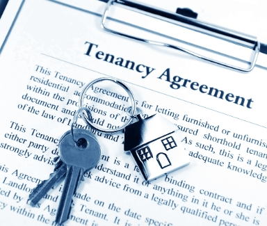 Landlord-Tenant agreement with keys on clipboard