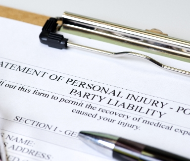 Statement of personal injury on clipboard