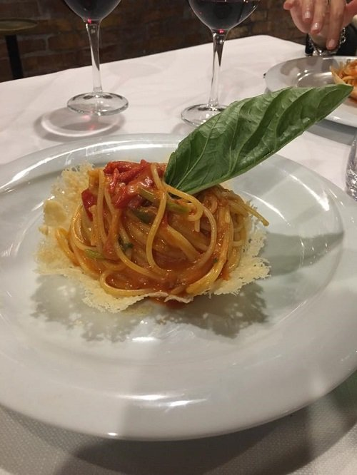 linguini plate with cherry tomatoes and basil