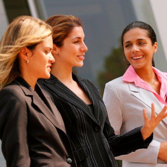 businesswomen talking