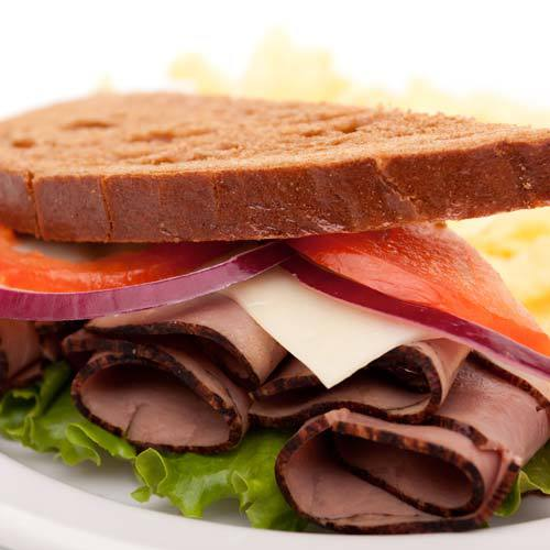 beef sandwich with cheese and onion