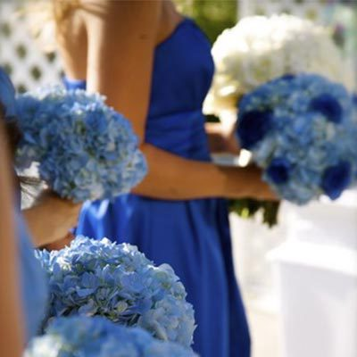 woman in blue dress with blue flowers