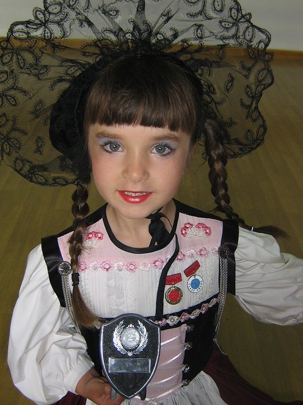 a small kid posing