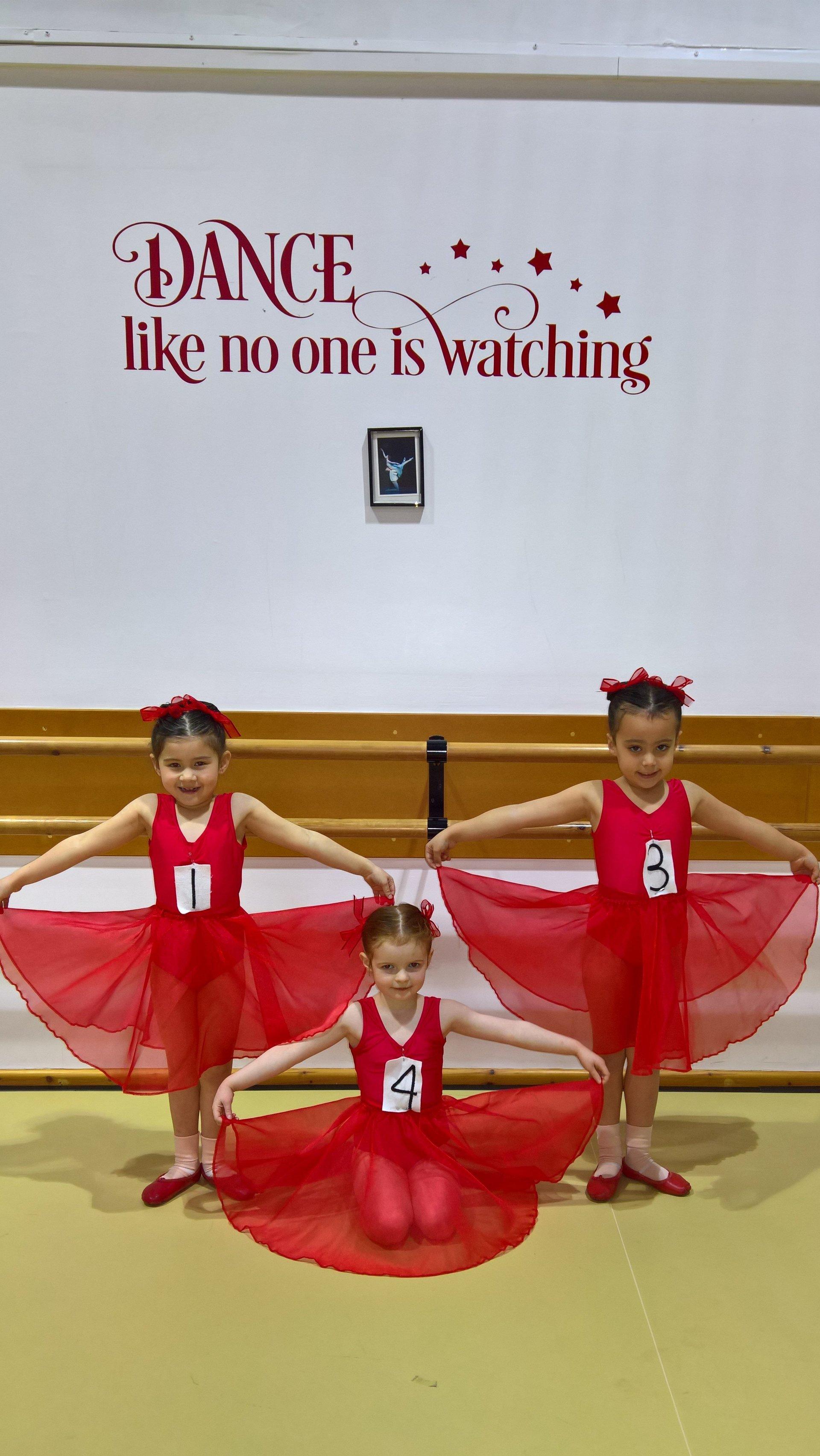 3 small girls dancing