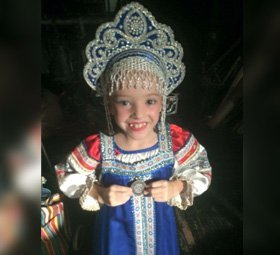 a small girl in dance costume