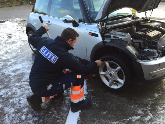 Tom changing a wheel and other vehicle repair