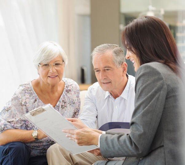 professional will advisor helping an elderly couple
