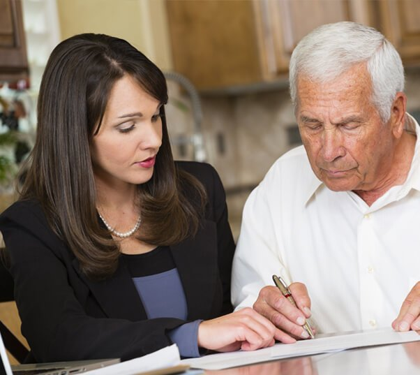 Old man signing a will