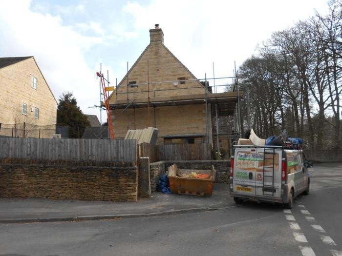 Loft conversion with scaffolding outside property