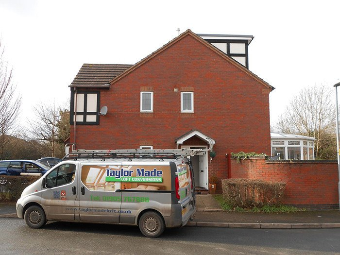 Taylor Made Conversions' van outside house