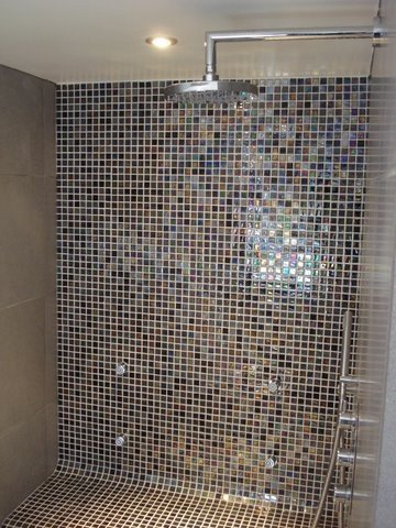 Large shower with mosaic tiles