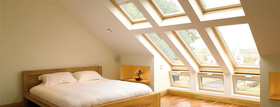 Converted loft bedroom with multiple rooflights