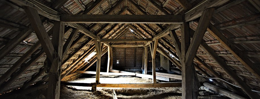 Old loft with wooden trusses