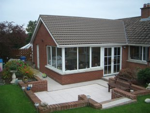A home with an extension and patio flooring completed by Adiar Bros