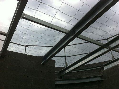 metal frames looking up at sky