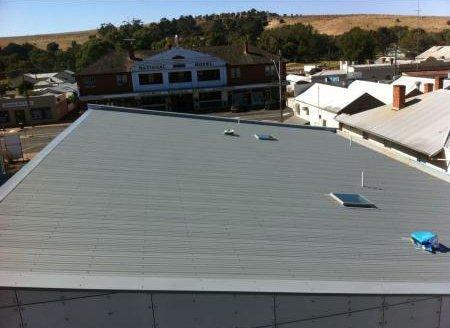 dark gray metallic roofing with small windows