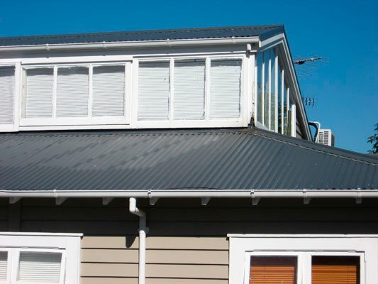 black metal roof and white trimmed windows