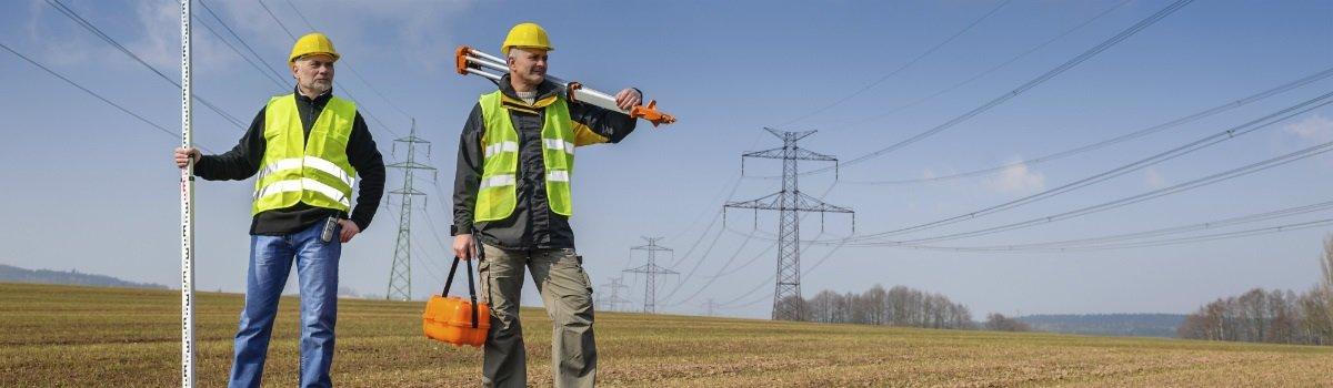 Two men doing site analysis on land near Frankston