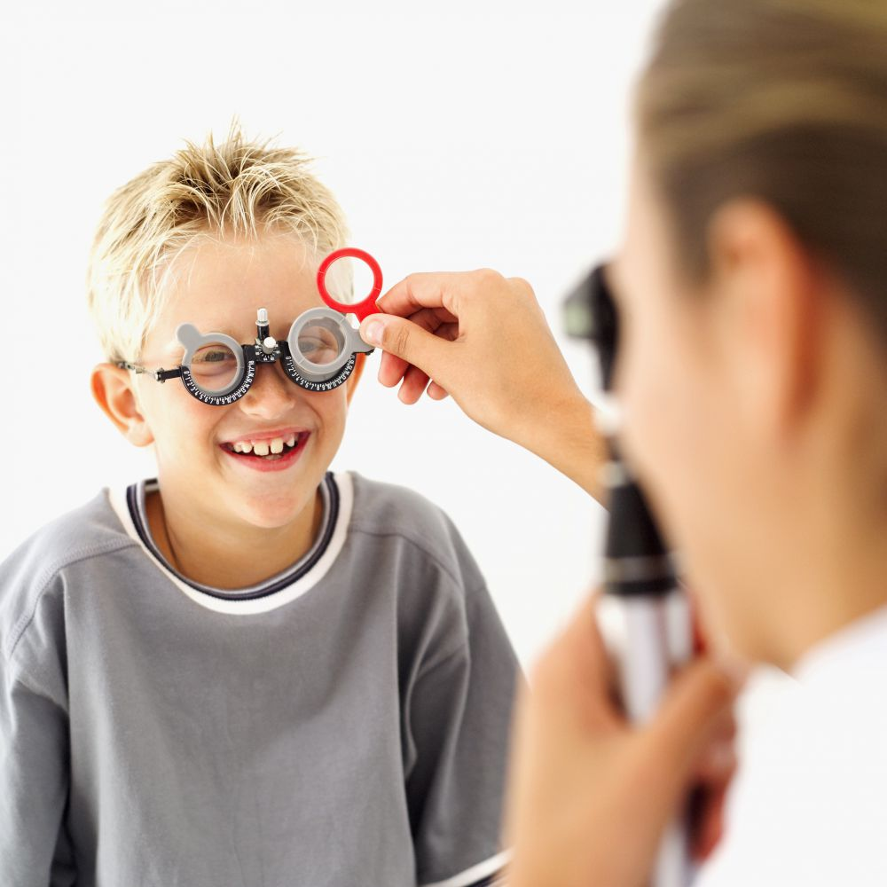 An optometrist is performing an exam on a child in Elko, NV
