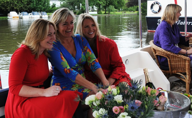 Happy party members on the 'Lily Anna'