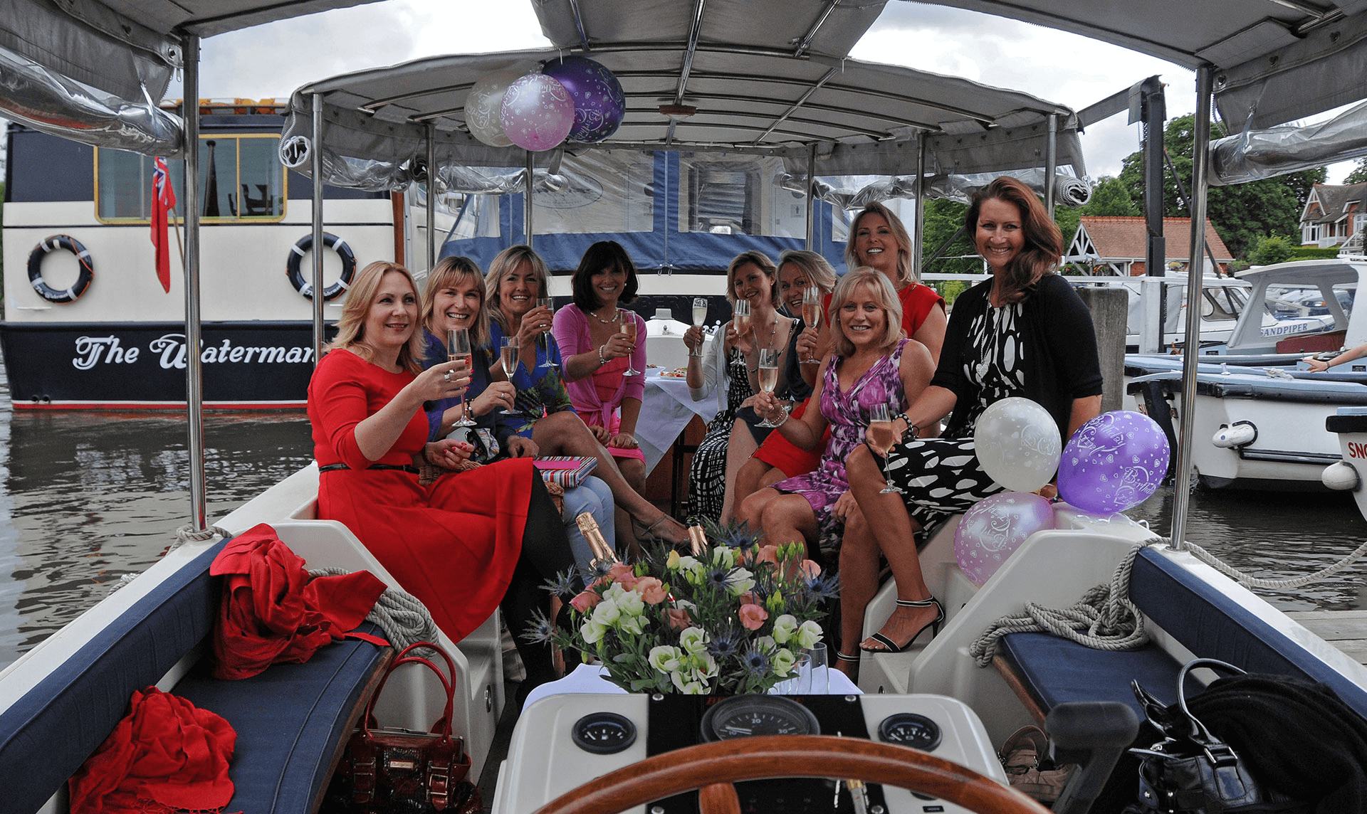 Ladies enjoying a party with champagne on deck