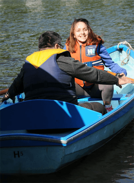 young girl enjoying rowing boat