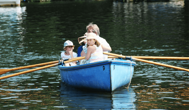 boat being rowed by a family