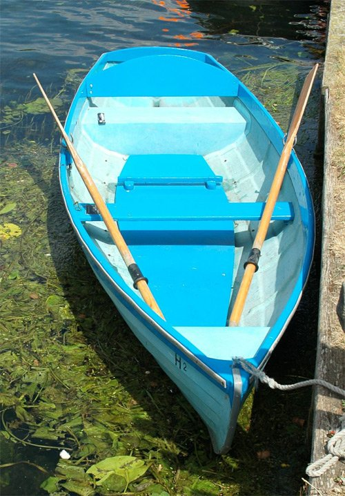 view from above of blue rowing boat