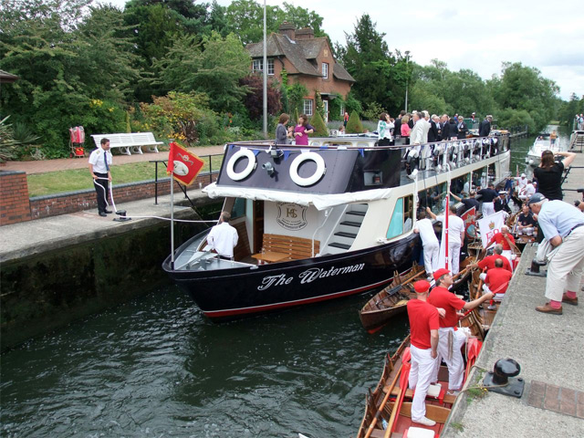 The waterman going through a Thames lock