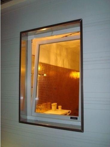 Finestra in alluminio-legno a ribalta