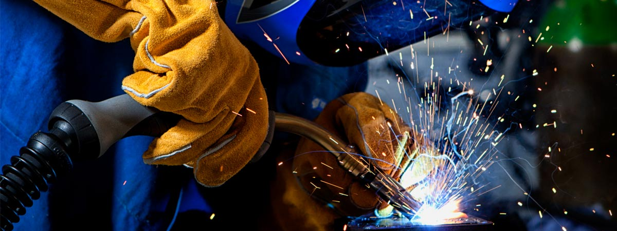 yates fabrication welder with welding sparks on metal surface