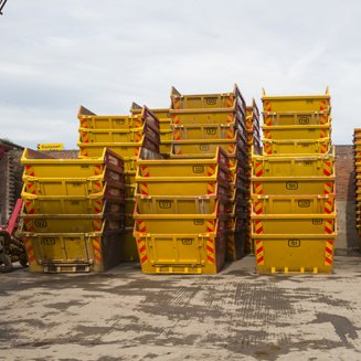 yellow waste containers stacked