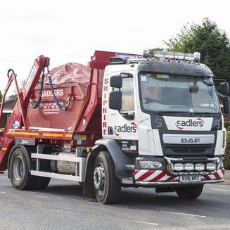 skip transporting waste