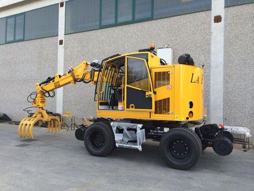 macchinario per costruzione rotaie giallo